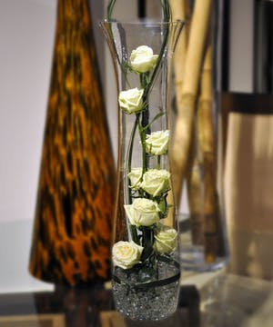 A brilliantly stylized design of white roses