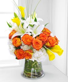 Bask in the beauty of summer with this stylish, elegant bouquet of premium blooms!