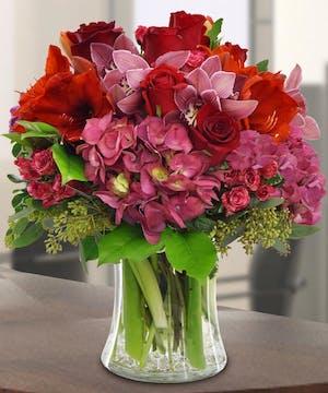 This gathering vase features premium floral varieties in romantic hues