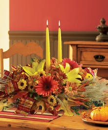 Set the perfect dinner table with this magnificent, twin taper-candled fall centerpiece.