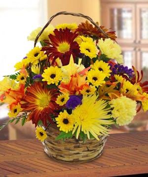 A basket of fresh cut fall flowers.