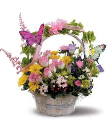 A feminine floral basket complete with butterflies