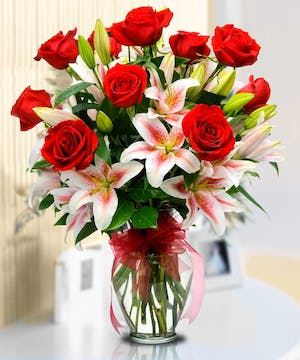 You can't go wrong with Roses and Stargazer Lilies!