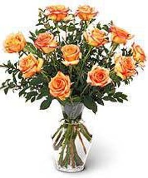 Dozen orange Roses vased and delivered