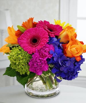 This bouquet is blooming with vibrant colors to bring a smile and delight to the face of that special recipient