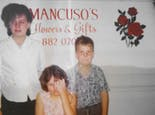 Three younger members of the Mancuso family lend a hand in the early 1980s